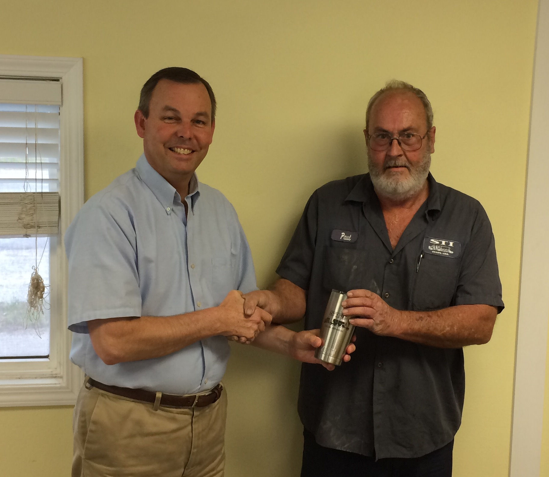 Paul Moore receiving Yeti appreciation cup from STI President James Knight.